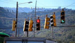 A collection of hanging traffic lights with contradictory signals.