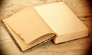 Antique book open to a blank page